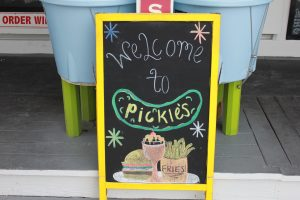 Enjoy a burger at Pickle's in Seaside to kick off the summer.