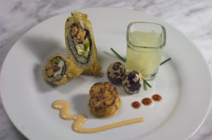 Boudreaux Roll- Blackened Grouper Cheek & Crawfish - Quail Egg Sake Shooter