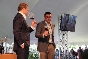 JCB and Brian Maloney of Boisset Family Estates discuss a few selections with guests of the wine festival.