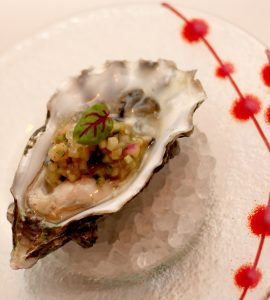 Live oyster with spicy aji amarillo and a cucumber mignonette